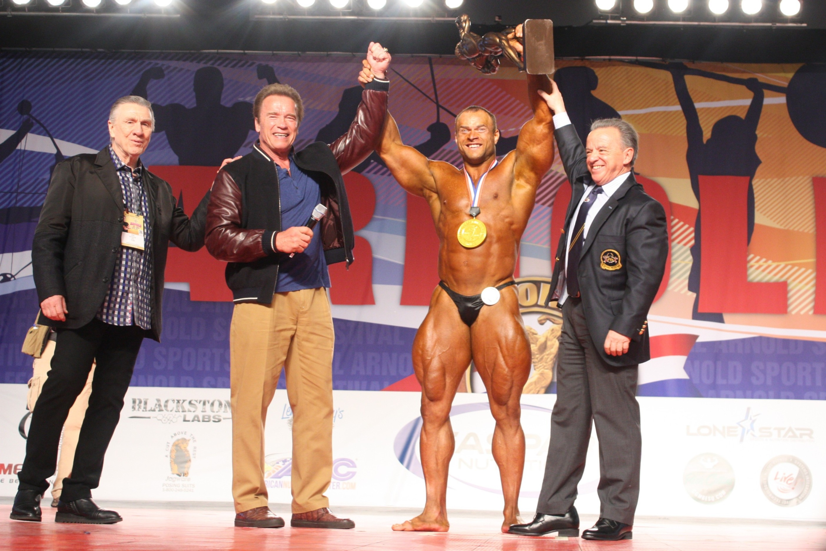 Men's Bodybuilding Overall Winner left to right Jim Manion, Arnold Schwarzenegger, Sergey Kulaev of Russia, Dr Rafael Santonja
