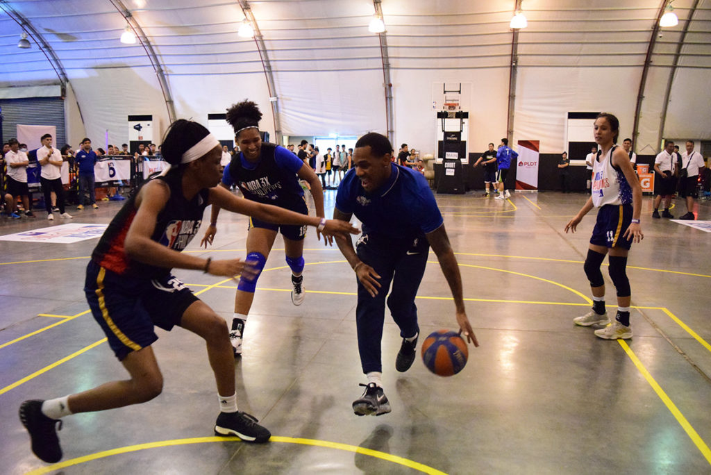 Denver Nuggets point guard Monte Morris plays an exhibition game with National University Lady Bulldogs.