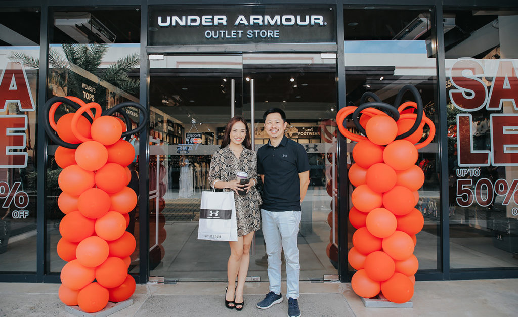 Princess Legaspi, Acienda's new ambassador and Mark Chan Mark Chan, President of Walk EZ Ratail Corp. in front of the new Under Armour Outlet Store