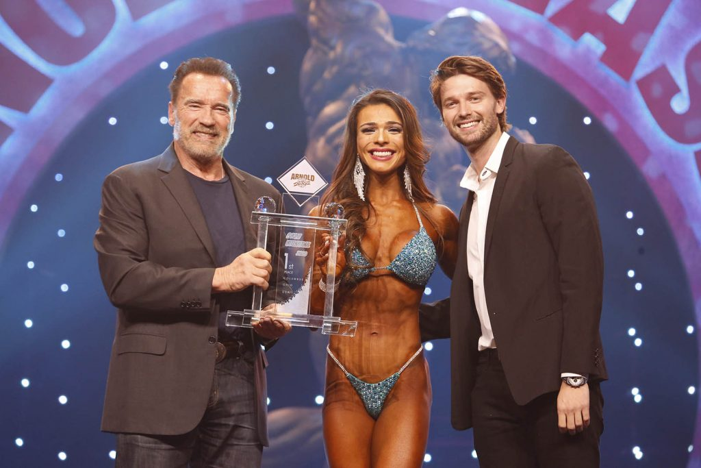 Bikini International winner Elisa Pecini with Arnold & Patrick Schwarzenegger