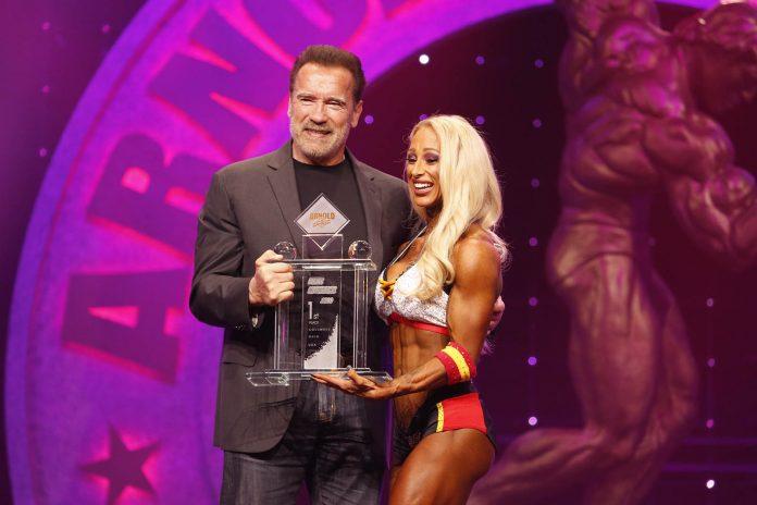Fitness International Winner Missy Truscott and Gov. Arnold Schwarzenegger photo by Dave Emery