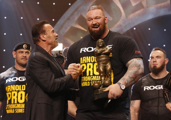 Hafthor Bjornsson wins The Arnold Strongman Classic with Gov. Arnold Schwarzenegger Photo by Dave Emery